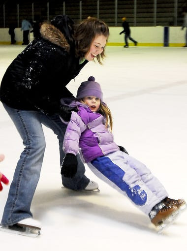 In this 2009 photo, Battle Creek's Amanda Subka, catches her sister, Ashley Lillard, 5, from falling during open skate at The Rink.