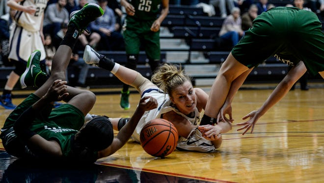 Lebanon Valley College's Hilary Yoh (center) fights for a loose ball with Stevenson's Imani Sanders (left) and Kaitlyn Van Tash (right) as LVC fell to Stevenson University 61-58 at Sorrentino Gymnasium on Wednesday night.
