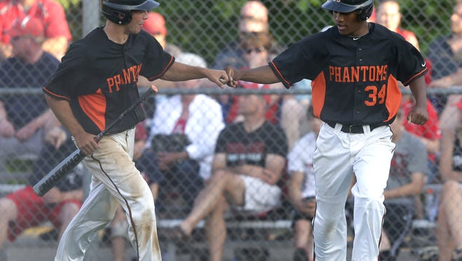 West De Pere High School's Sam De Ruyter, left, and Matthew McNabb celebrate scoring against Kimberly High School during their WIAA Division 1 baseball sectional championship game Tuesday, June 9, 2015, at Nienhaus Sports Complex in Appleton, Wis.  Dan Powers/Post-Crescent Media
