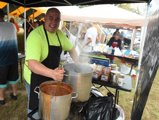 Holy Smokes BBQ owner Matt Woods has his hands full