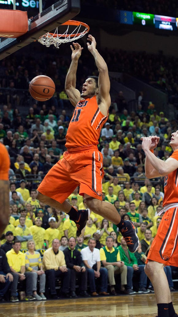 Oregon State guard  Malcolm Duvivier with a put-back dunk early in the first half in Saturday's 91-81 loss at No. 16 Oregon.