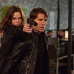 "Rebecca Ferguson, left, and Tom Cruise, right, in ""Mission: Impossible – Rogue Nation,"" which opened Friday."