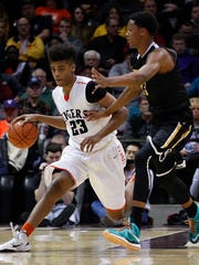 Waynesville's Juwan Morgan brings the ball up court against Bishop O'Dowd's Ivan Rabb at JQH Arena during opening night of the Tournament of Champions.