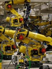 New robots that Fiat Chrysler Automobiles is setting up in their assembly plant in Windsor, Canada on Monday, February 9.