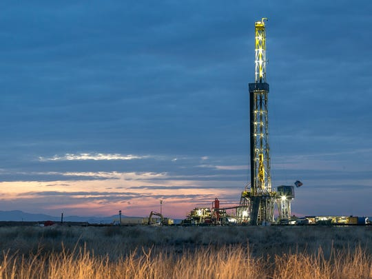A drilling rig works near the southern edge of the famous Permian Basin region of Texas, in this Standard-Times file photo. Recent slowdowns in the oil fields are triggering layoffs around the state.