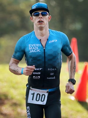Christopher Douglas completes the 10K run to win the 36th annual Memphis In May Olympic Triathlon at Edmund Orgill Park in Millington. The 1.5K swim, 40K bike and 10K race is one of the oldest continuous running triathlons in the country.