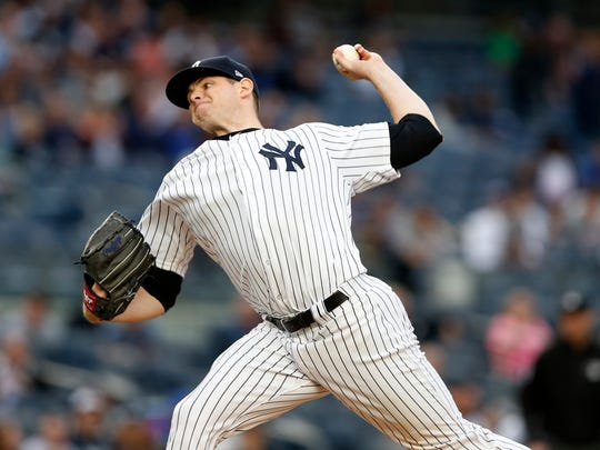 New York Yankees starting pitcher Jordan Montgomery delivers during the first inning of a baseball game against the Kansas City Royals at Yankee Stadium in New York, Tuesday, May 23, 2017.