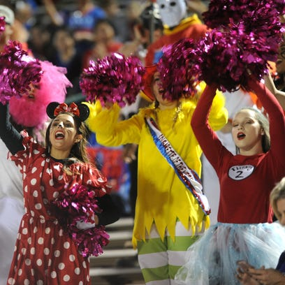 Cooper students cheer for their football team during