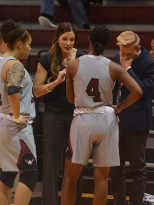 McMurry women's basketball coach Brittany Densman-Roes talks to Skyler Reyna, left, and Sham Hunter (4) during a timeout late in the War Hawks' 68-63 win Saturday, Jan. 13, 2018, at Kimbrell Arena.