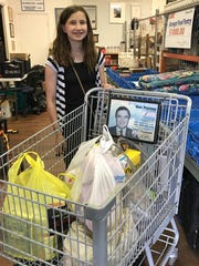 Alexa Daley delivers goods to Barnegat Food Pantry.