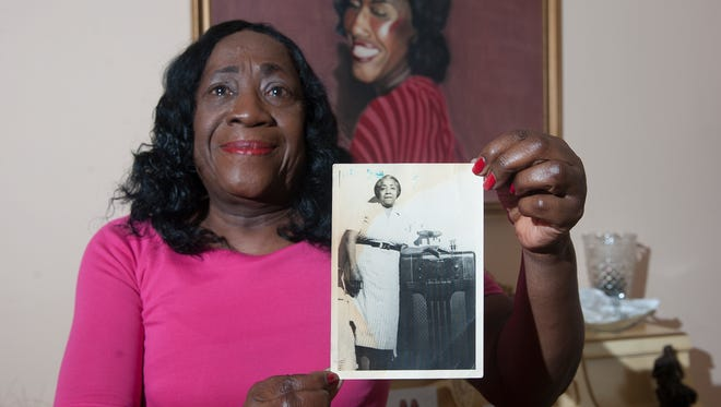 Janett Galloway, of Collingswood, show a photograph of her Grandmother Mary Galloway whom donated clothing worn by a family member years ago, who was a slave. The clothing will be on display this weekend for the National Museum of African American History and Culture in D.C.