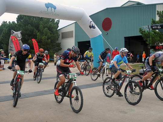 A group of Cat 2 riders leave the starting line at