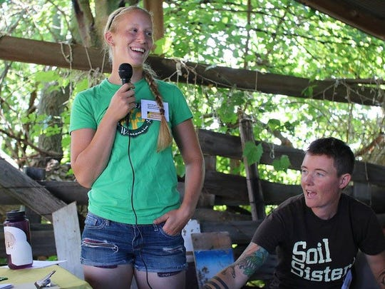 Bethanee Wright of Winterfell Acres speaks at a MOSES (Midwest Organic and Sustainable Education Service) In Her Boots workshop, next to Lindsey Morris Carpenter of Grassroots Farm.