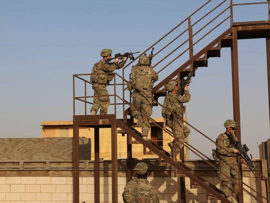 Soldiers from 1st Battalion, 77th Armor Regiment practice clearing a stairwell during Military Operations on Urban Terrain training.