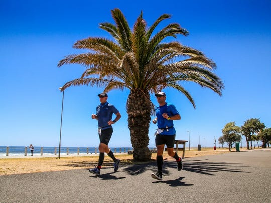 7 marathons, 7 continents, 7 days: Knoxville resident Brian Winter completed that feat this year becoming one of only several hundred runners to finish the World Marathon Challenge. Here he is running in Cape Town, South Africa, with friend Andrew Brooks.