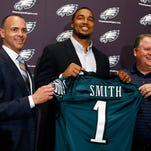 Marcus Smith (center) stands with team president Don Smolenski and head coach Chip Kelly on May 9.