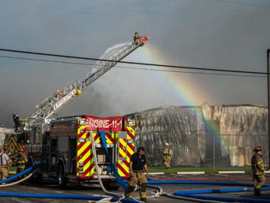 A West York fire truck sprays down a portion of the