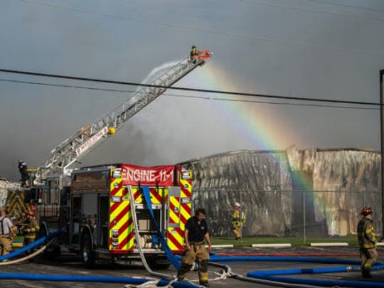 A West York fire truck sprays down a portion of the burned structure at Miller Chemical and Fertilizer on Monday, June 8, 2015.  - The Evening Sun