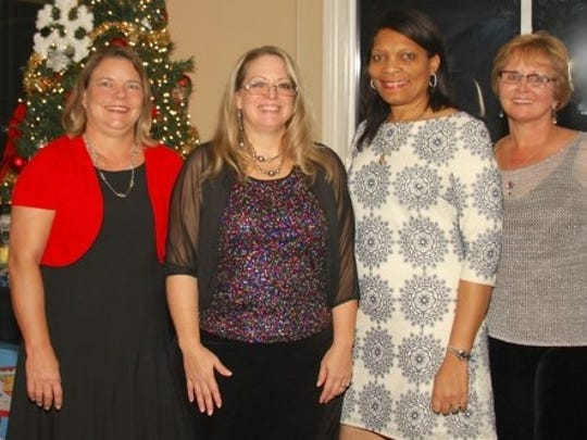 New Port St. Lucie Business Women officers: Incoming President Michelle MacNichol, Vice President Tammy Crandell, Secretary Angela Hayle and Treasurer Susan Fines