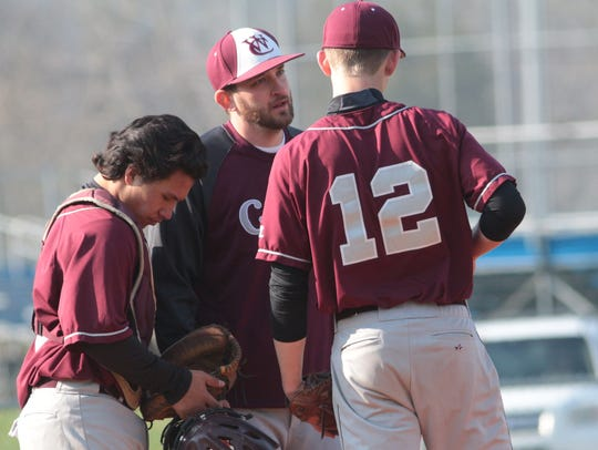 West Creek coach Will Jobe talks to his starting pitcher