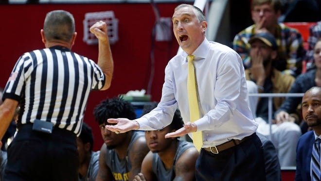 Arizona State head coach Bobby Hurley argues with an official in the first half of an NCAA college basketball game against Utah, Sunday, Jan. 7, 2018, in Salt Lake City. (AP Photo/Rick Bowmer)