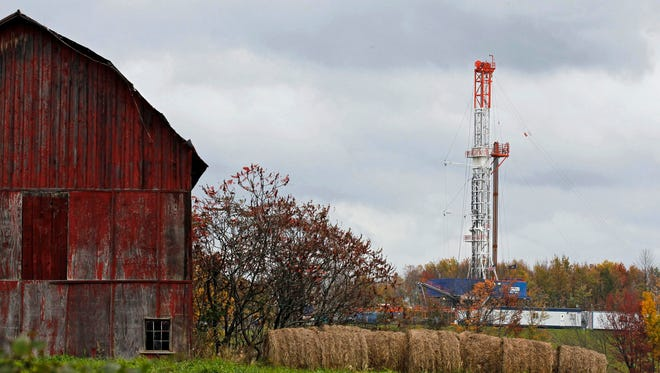 A drilling rig is set up to tap gas from the Marcellus Shale gas field in this file photo.