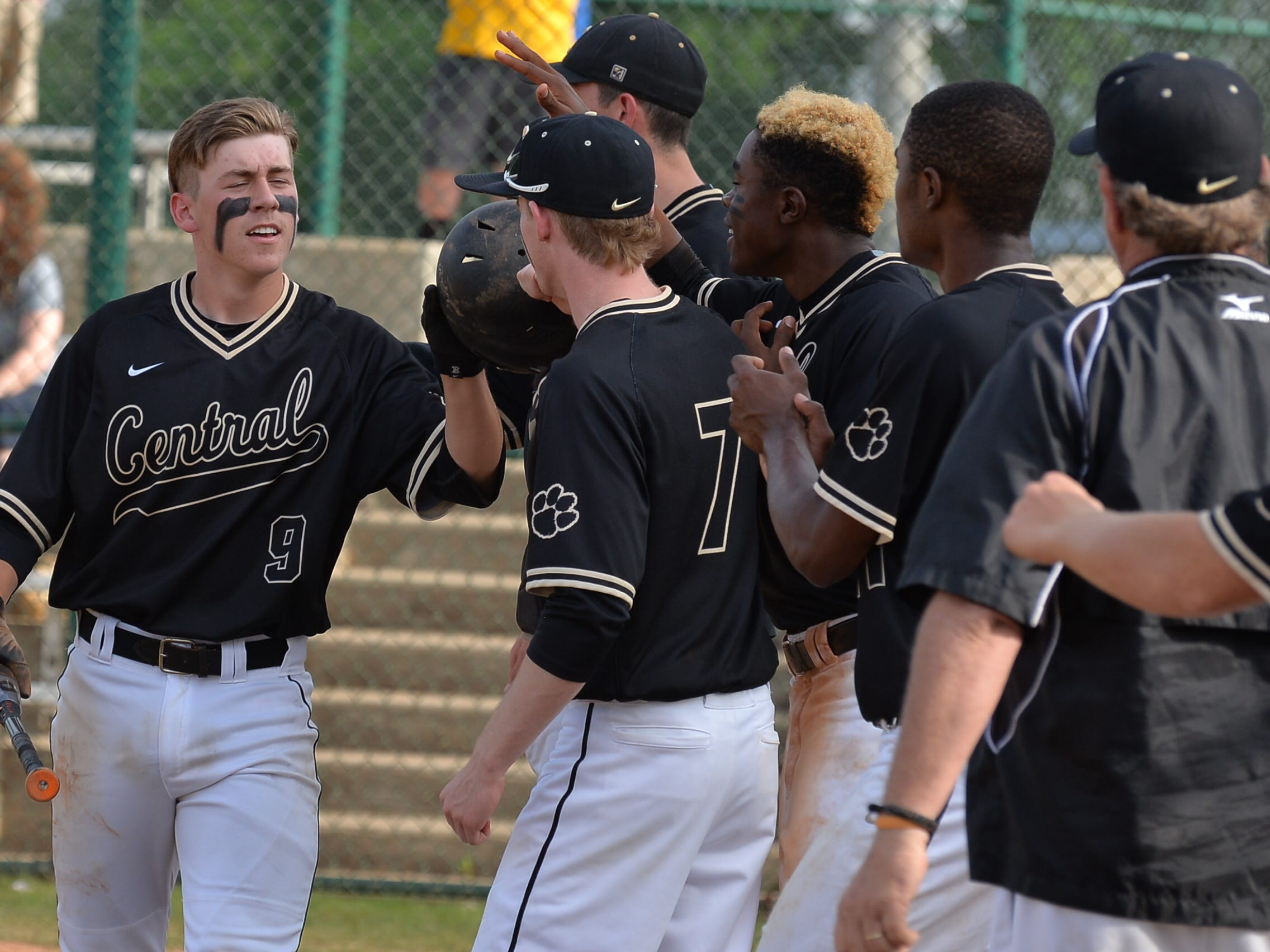 Central Magnet's Darek Sargent (9) celebrates with teammates during Friday's 4-0 win over Sequoyah.