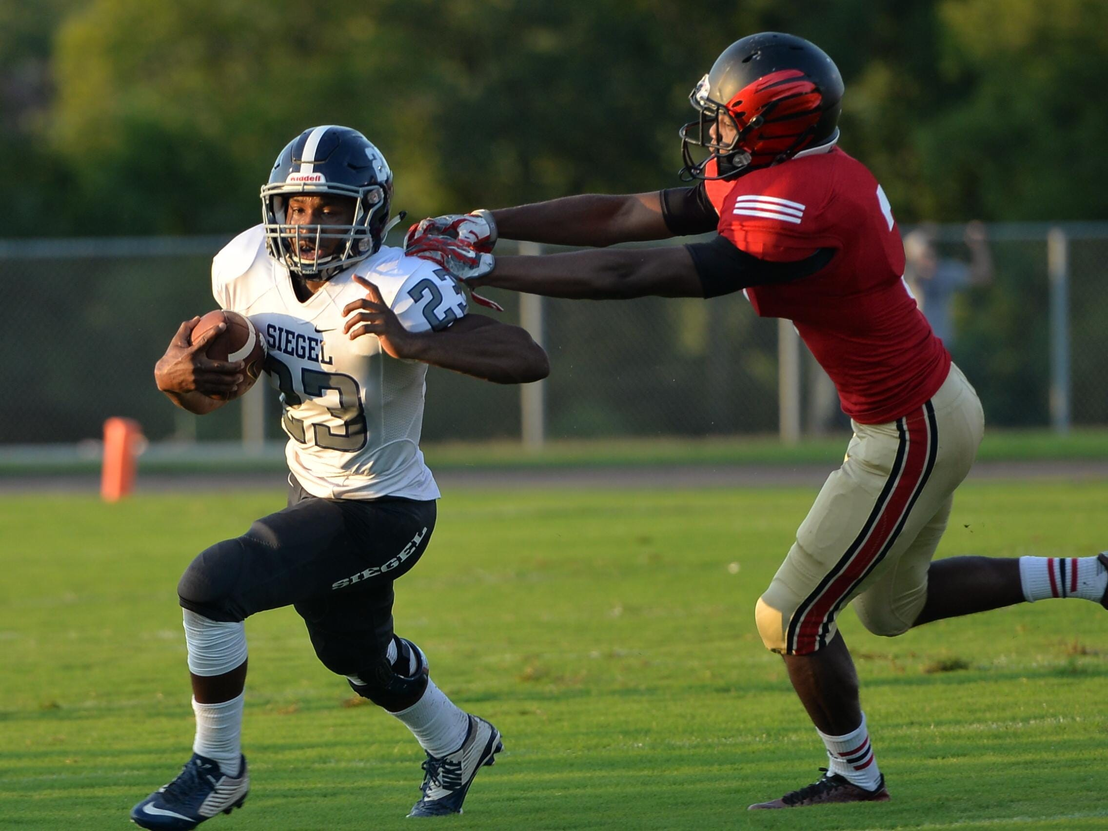 Siegel's Greedy Howse (23) rushed for 180 yards in the Stars' 47-27 loss to Ravenwood on Thursday.