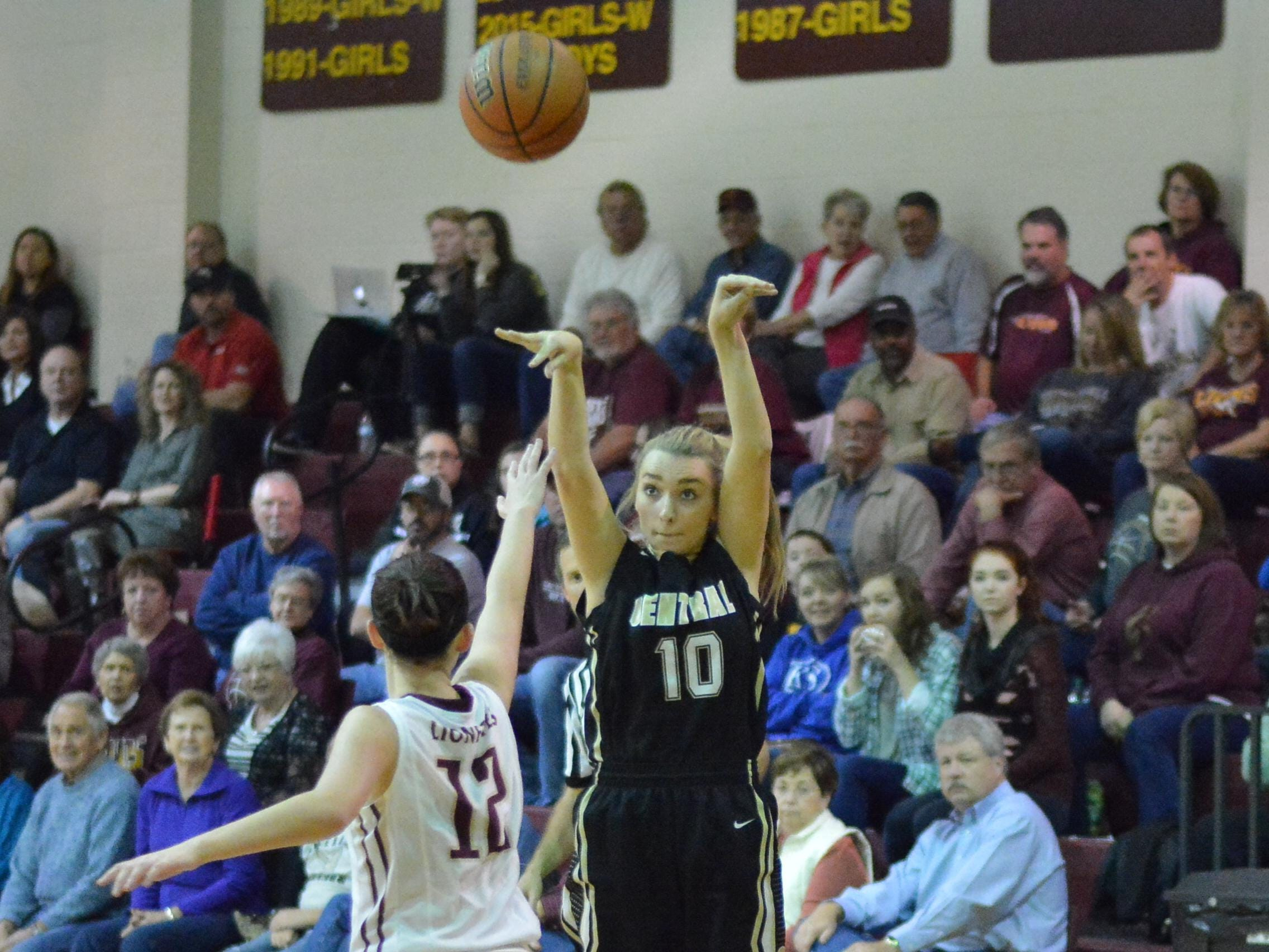 Central Magnet's Nina Kelly shoots a jumper during the Lady Tigers' game with the Lionettes.
