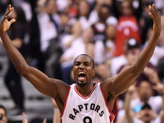 FILE - In this Sunday, May 7, 2017, file photo, Toronto Raptors forward Serge Ibaka (9) celebrates after making a three-pointer against the Cleveland Cavaliers during second half NBA playoff basketball action in Toronto. A person familiar with the negotiations said Ibaka is staying with the Toronto Raptors, agreeing to terms on a 3-year, $65 million deal. The person spoke to The Associated Press Sunday, July 2, on condition of anonymity because the deal cannot be finalized until next week. (Frank Gunn/The Canadian Press via AP, File)