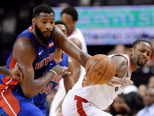 Detroit Pistons center Andre Drummond (0) steals the ball from Toronto Raptors forward CJ Miles (0) during the second half of an NBA basketball game in Toronto on Wednesday, Jan. 17, 2018. (Frank Gunn/The Canadian Press via AP)