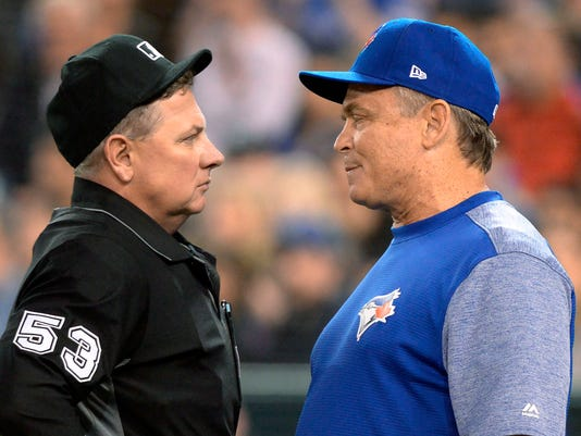 Toronto Blue Jays manager John Gibbons argues a call with home plate umpire Greg Gibson during the fifth inning of the team's baseball game against the Chicago White Sox on Wednesday, April 4, 2018, in Toronto. (Nathan Denette/The Canadian Press via AP)