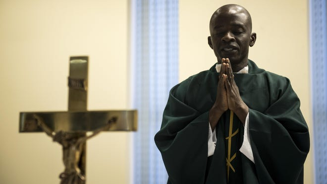 Chaplain (Capt.) John Appiah, a 455th Air Expeditionary Wing chaplain, leads a prayer during a religious service at Hamid Karzai International Airport, Kabul, Afghanistan, July 23, 2017. Religious support teams from the 455th AEW provide spiritual support in more than six locations throughout Afghanistan.
