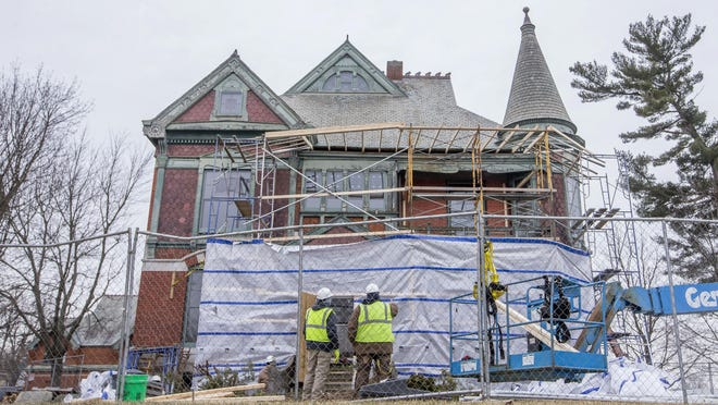 In a Wednesday, Feb. 27, 2019 photo, scaffolding is built around the Henry A. Chapin House, also known as Chapin Mansion, while work is done on the historic home, in Niles, Mich.
