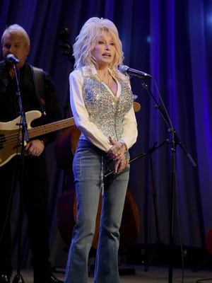 """Dolly Parton rehearses at the pre-taping for the """"Dolly Parton's Smoky Mountains Rise: A Benefit for the My People Fund"""" Tuesday, Dec. 13, 2016, in Nashville, Tenn."""