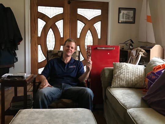 Todd Schweisinger inside his modest home near Clemson.