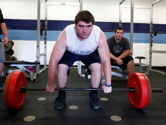 John Jay lineman Max Maybaum works out in the weight