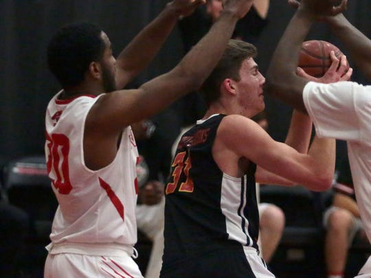 photos by Richard Lui/The Desert Sun Palm Springs' Damion Lee, left, and Deondre Hawkins surround Palm Desert's Dalton Casserly-Simmons during their game Tuesday in Palm Springs. Palm Desert won 39-31 despite not scoring from the field in the second quarter. Palm Desert's Dalton Casserly-Simmons is consumed by Palm Springs' Damion Lee, left, and Deondre Hawkins on Tuesday, January 26, 2016 in Palm Springs.