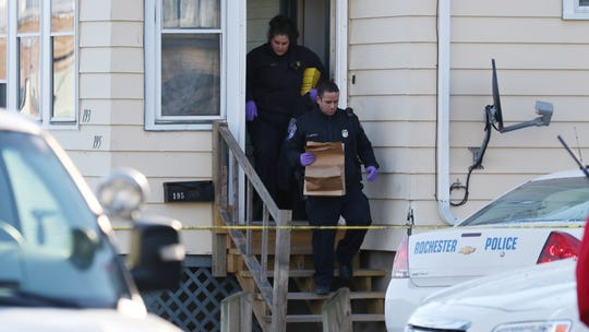 Police technicians carry out evidence during their