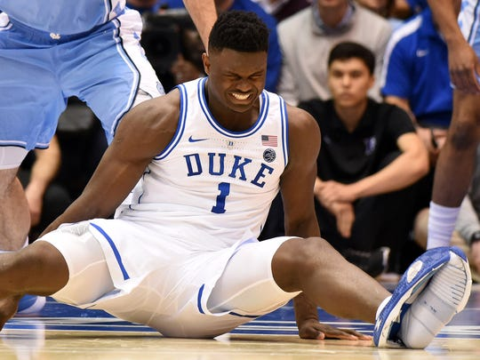 Feb 20, 2019; Durham, NC, USA; Duke Blue Devils forward Zion Williamson (1) reacts after falling during the first half against the North Carolina Tar Heels at Cameron Indoor Stadium. Mandatory Credit: Rob Kinnan-USA TODAY Sports