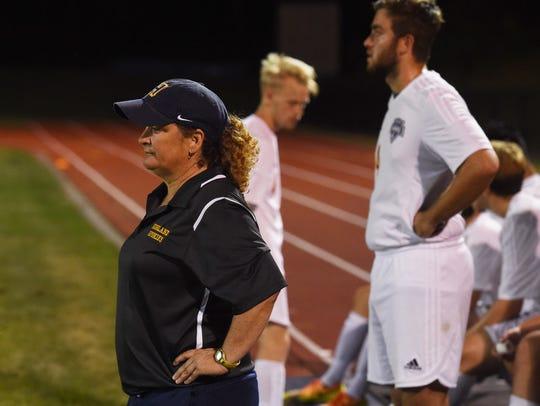 Terri Cilento, left, coach for Highland High School's