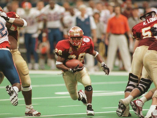 With Kevin Long and Todd Fordham blocking, Warrick Dunn races through a huge hole against Florida in the 1995 Sugar Bowl.