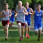 Milford girls took the top seven places against rival Lakeland in the first dual meet of the year for the Mavericks.