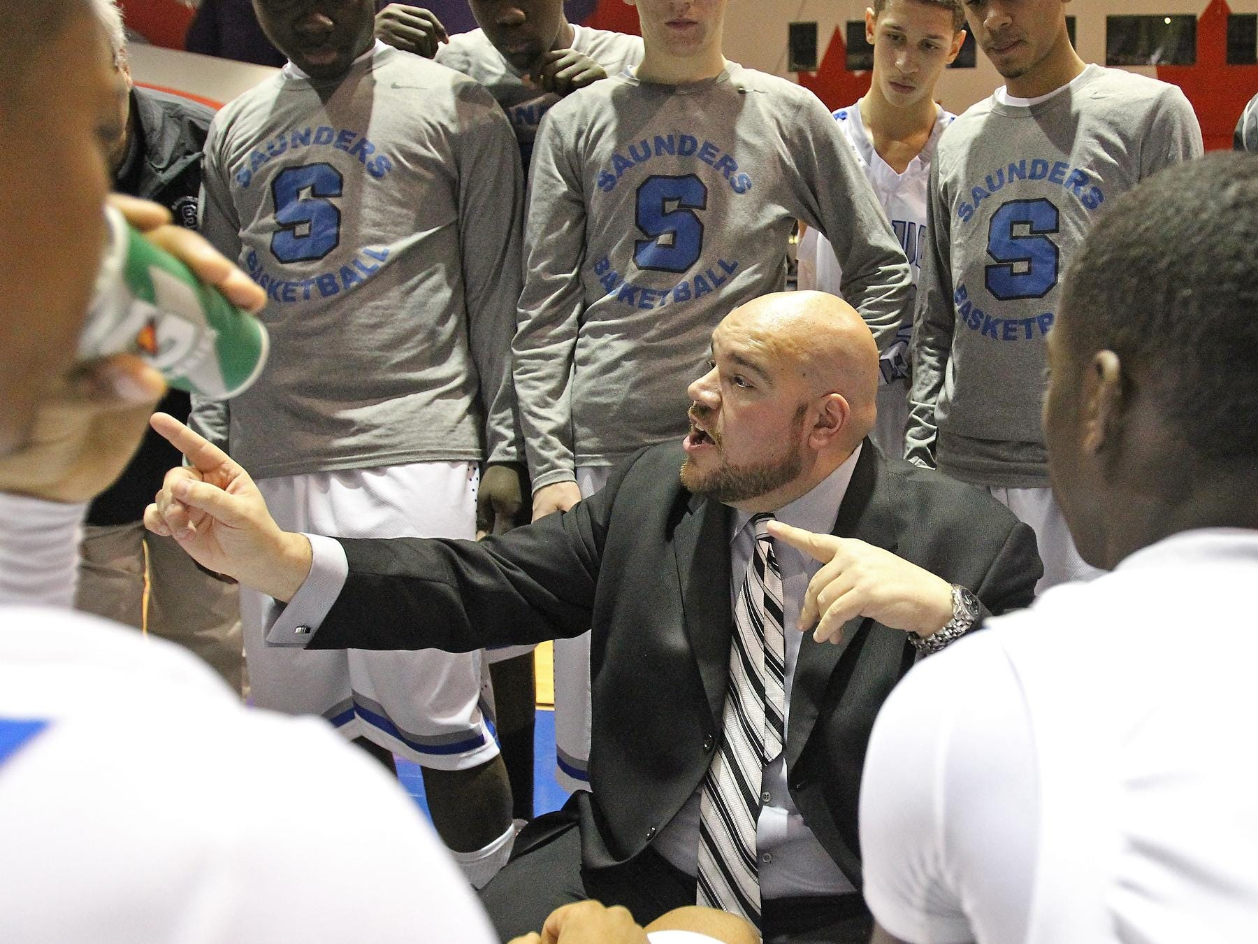 """Saunders boys basketball head coach Anthony Nicodemo, seen at a January game in New Rochelle, came out as gay and won praise and support. He called Friday's Supreme Court ruling """"stunning."""""""