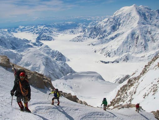 A team from Veterans Expeditions works their way to