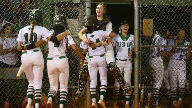 Fort Myers High celebrates a go-ahead run against Estero in a Class 7A regional semifinal softball game on Tuesday, May 8, 2018.