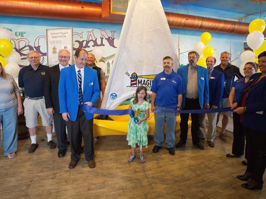 Chamber of Commerce ambassadors conducted a ribbon cutting at the newly donated dinghy Thursday June 23, 2016 at the Above and Beyond Children's Museum in Sheboygan. The sailing organization SEAS donated the craft to the museum to help foster education on sailing.
