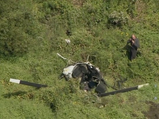 An investigator photographs the scene of a fatal helicopter crash in Burlington County that killed country music star Troy Gentry. This image was taken from aerial video footage taken by NBC 10 News in Philadelphia.
