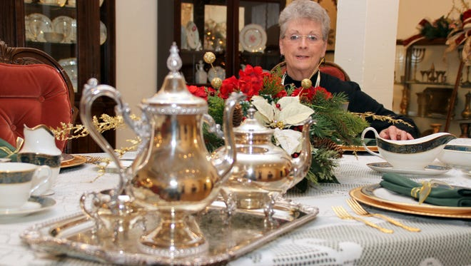 Deming-Luna-Mimbres Museum Board Member Sylvia Coussons looks over the pace settings and tea service in preparation ffor the annual Green Tea event, from 1:30 to 4 p.m. Sunday at the museum. Coussons invites all to the free event.