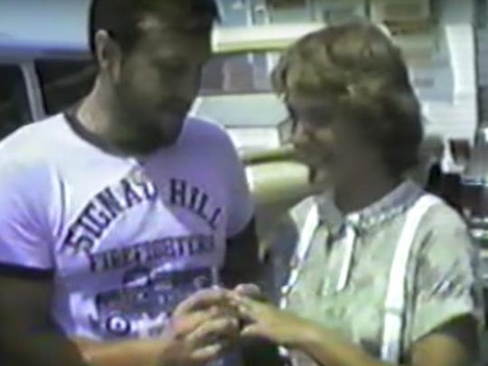 In this screen grab from a video produced by the late Bob Ketchum, Bob and Patty Lelly exchange wedding rings on the Norfork Lake ferry on Aug. 8, 1980.